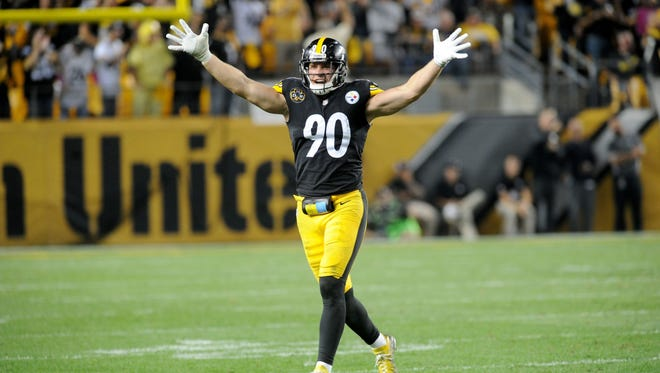 Pittsburgh Steelers linebacker T.J. Watt (90) celebrates a sack against the Cincinnati Bengals in the fourth quarter at Heinz Field.