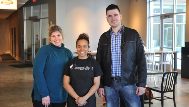 Construction continues at Jones 421 downtown, with more businesses set to open this spring. Left to right: Leigh McCoy of Bella Rosa Floral, Inkka Beaudion of Swamp Daddy's Cajun Kitchen, and Borjan Jaksic of Boki Mediterranean Street Food and Boki Gelato.