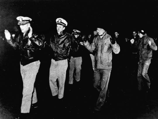 Crew members of the U.S. Navy intelligence ship USS Pueblo are led into captivity after the vessel was seized by North Korean patrol boats in the Sea of Japan in Jan. 1968.