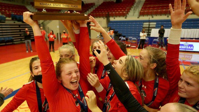 Ottawa volleyball celebrate their third place win in the Class 4A State Volleyball tournament at the Sports Arena Friday evening. Ottawa defeated McPherson 9-25, 25-12, 25-21, to place third in the tournament.