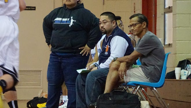 Guam High Panthers boys' basketball coaches, from left, Arleen Mad, Ben Leon Guerrero and head coach Joe Taitano will share coaching duties this season. Mad was the stand-up assistant during their GSPN Pre-Season Boys' Basketabll Tournament game at St. John's School on Saturday, Jan. 9.
