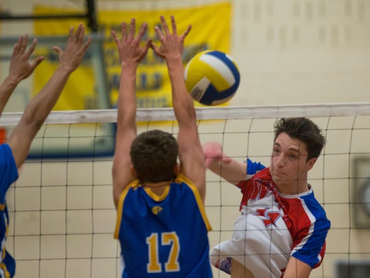 Wall's Nick Palluzzi returns a shot during first game action. Wall Boys Volleyball vs Manchester in Manchester, NJ on April 25, 2017