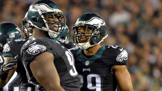 Oct 12, 2014: Philadelphia Eagles defensive end Fletcher Cox (91) and safety NAte Allen (29) react after stopping New York Giants running back Andre Williams (not pictured) during the third quarter at Lincoln Financial Field.