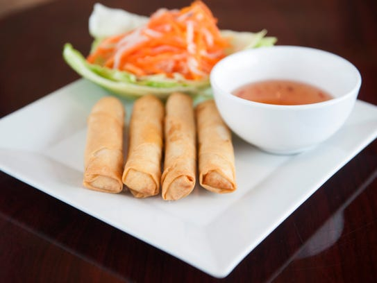 Crispy spring rolls are on served with a dipping sauce at Pho 9.