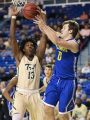 Delaware guard Ryan Daly throws a pass around William and Mary's Nathan Knight in the first half of the Hens' loss Friday.