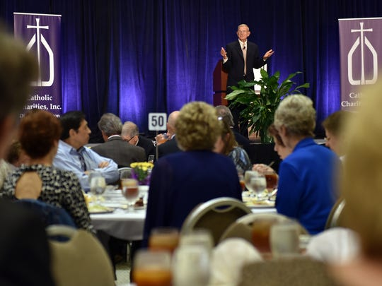 Lou Holtz speaks at the Jackson Convention Complex during a Diocese of Jackson Journey of Hope Catholic Charities event Wednesday.