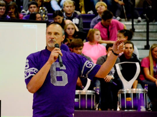 Shawn McCarthy speaks during the Ross High School homecoming pep rally Friday afternoon.