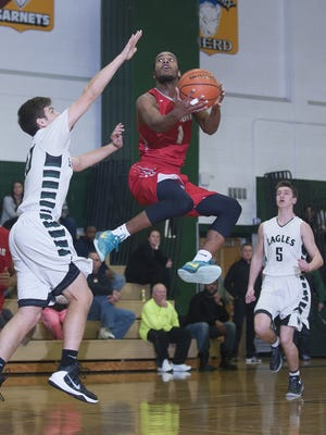 Paulsboro's Tyrique King, goes up toward the basket against West Deptford's Zach Peterson, left, during the third quarter of Thursday's game.