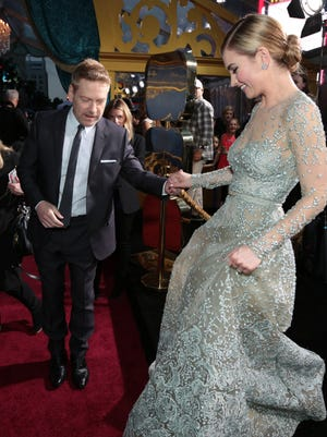 Kenneth Branagh and Lily James arrive at the premiere for 'Cinderella' on Sunday.