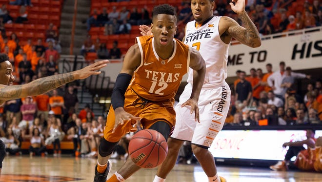 Oklahoma State guard Jeff Newberry reaches for the ball as Texas guard Kerwin Roach Jr. drives to the basket during the first half at Gallagher-Iba Arena.
