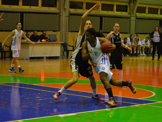 Former MSU women's basketball player Lykendra Johnson (12) is averaging 13.5 points and 9.3 rebounds per game for AE Ellinikou in the Greek League this season.
