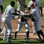 New York Yankees' Chase Headley, right, celebrates with Starlin Castro after hitting a grand slam home run against the Colorado Rockies during the second inning of a baseball game, Wednesday, June 22, 2016, in New York.
