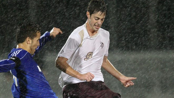 Ryan Aspenleiter, right, shown playing for Pittsford Mendon in 2014, was a backup the past two seasons for the University at Buffalo Bulls. UB announced Monday that men's soccer was one of the four sports it is dropping.