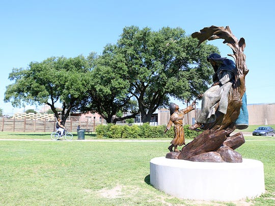 The Lady in Blue and a Jumano Indian are depicted in this bronze statue that was installed beside the Concho River in May.