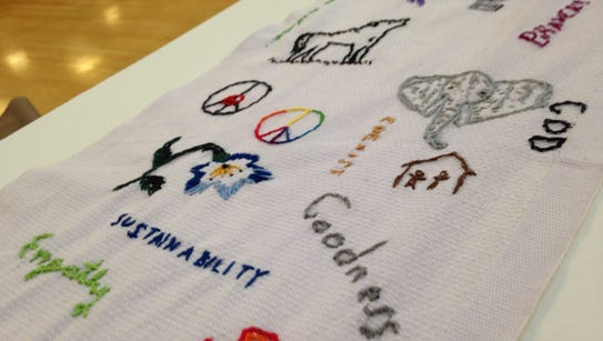 Embroidered words and symbols adorn the cotton roller