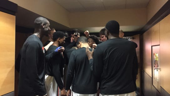 Oregon State players gather before taking the court
