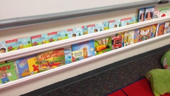 Rain gutter bookshelves are simple inexpensive way