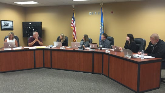 Harrisburg School Board members discuss an early college