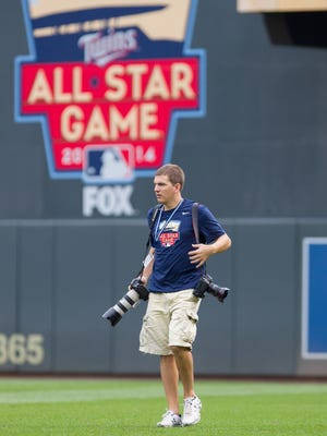 St. Cloud Cathedral and St. John's University graduate Brace Hemmelgarn is the Minnesota Twins' team photographer.