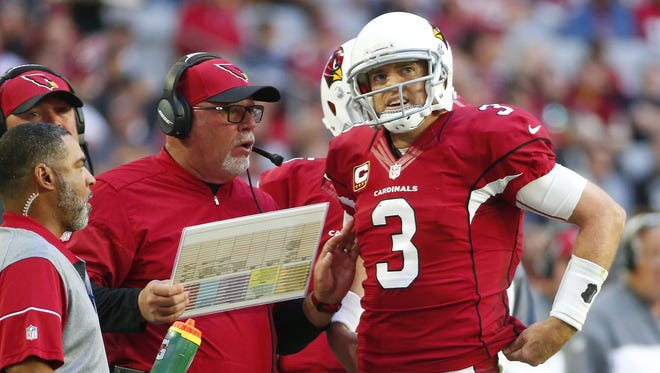 Cardinals head coach Bruce Arians talks with quarterback Carson Palmer (3) during a break against the Redskins during the second quarter at University of Phoenix Stadium December 4, 2016.