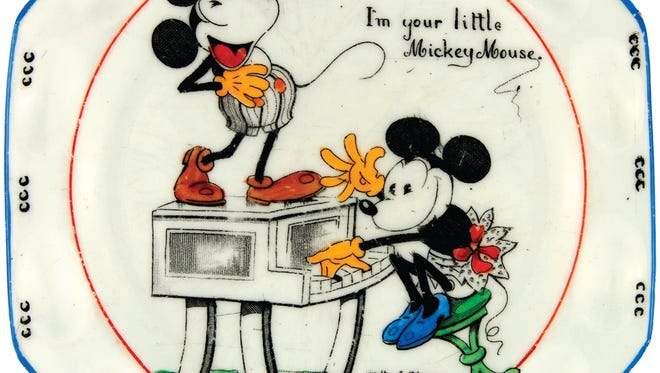Mickey Mouse is one of the best-known characters in the world. This 1930s dish, listed by Hake's as an olive plate, shows early pictures of Mickey and Minnie dancing and playing the piano. It sold for $345.