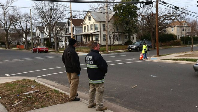 Forensics experts from the Monmouth Co. prosecutor's office at the scene of the Jamar Small murder on Summerfield Ave. in Asbury Park—December 21, 2015-Asbury Park, NJ.-Staff photographer/Bob Bielk/Asbury Park Press