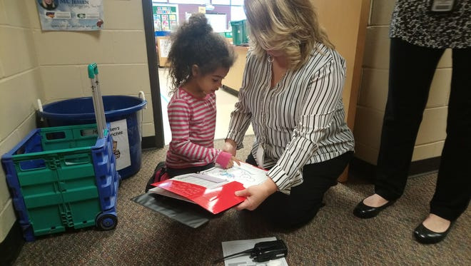 Kindergartner Amelia Green-Erving walks Kirkwood principal Anita Gerling through an AVID binder and how goals work in her class.