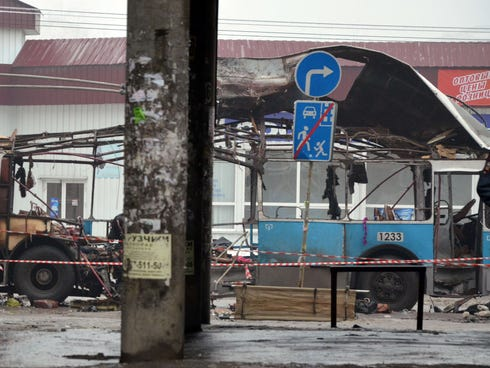 A destroyed trolleybus stands on a street in Volgograd on Monday after 10 people were killed in a bombing on the packed vehicle.