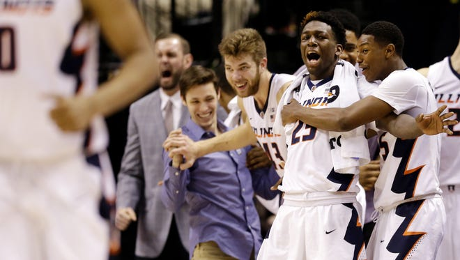 Illinois Fighting Illini's Aaron Jordan (23) reacts with teammates Michael Finke (43) and Kendrick Nunn (25) after a late three-pointer by the team against the Minnesota Golden Gophers at Bankers Life Fieldhouse in Indianapolis on March 9, 2016.