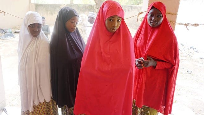 Zahra Bukar, 13, Fatima Abdu, 14, Fatima Abdulkarim, 15 and Yagana Mustapha, 15 four schoolgirls of Government Girls Technical College, who escaped from Boko Haram attack, arrive at home of schoolmate at Dapchi town in northern Nigerian on Feb. 28, 2018.