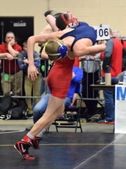 Riverheads' G.W. Shultz, the All-City/County Wrestler of the Year, takes Parry McCluer's Dylan May to the mat during their 113-pound quarterfinal bout at the VHSL Group 1A wrestling championships. Shultz went on to win by fall on his way to the state title.