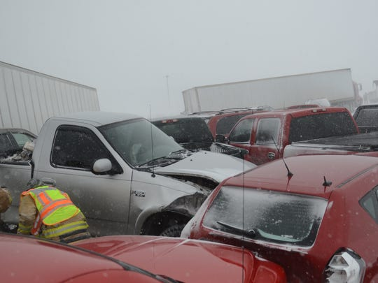 Emergency personnel work at the scene of a multi-vehicle