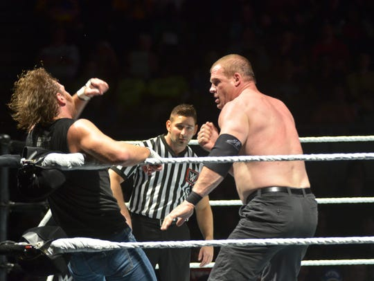"""Knox County Mayor Glenn Jacobs performs as the unmasked version of his WWE character Kane (right) against Dean Ambrose during a """"WWE Live"""" event at the Pensacola Bay Center"""