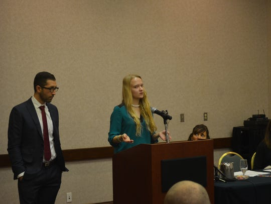 Emily Kollaritsch stands alongside her lawyer Alex Zalkin during a 2015 news conference announcing a new Title IX civil lawsuit against Michigan State University.