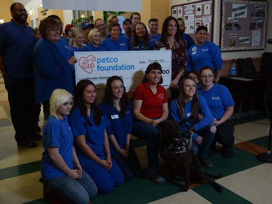 Linda Hibbard and her dog Brindy pose with Nevada Humane Society volunteers for a photo Tuesday after Petco Foundation awarded $100,000 to the Nevada Humane Society.