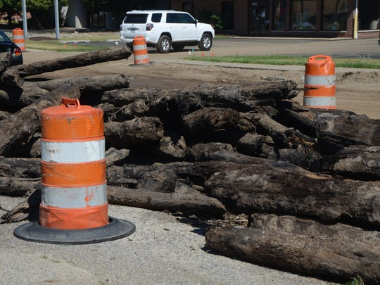 More than two dozen logs rest along Territorial Road