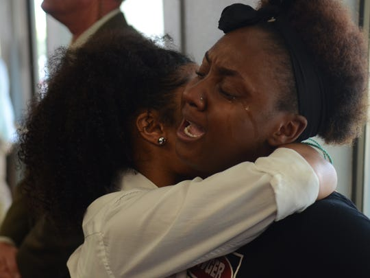 KaPreace Young, 19, cries during Sunday's empowerment vigil in south Reno.