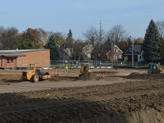 Crews working outside Fairview STEM Magnet School Friday, Nov. 18, 2016. An expansion of the K-3 building is planned as part of the district's $120 million Pathway Promise millage.