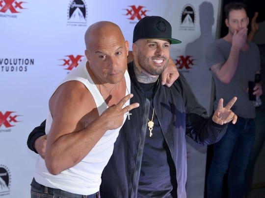El cantante Nicky Jam (der.) al lado del actor Vin Diesel.