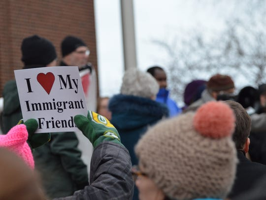 A sign declaring love for immigrant friends is displayed