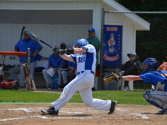 Harper Creek's Sam Bussler takes a swing in this Division