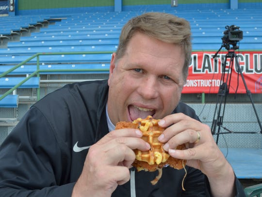 The Battle Creek Enquirer's Bill Broderick tries the BBQ Bomber - the new food item for the Battle Creek Bombers