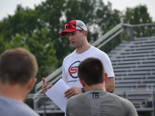Evan Sharpley talks to quarterbacks at the Sharpley Training QB Mini-Camp at Harper Creek on Friday, July 21, 2017.