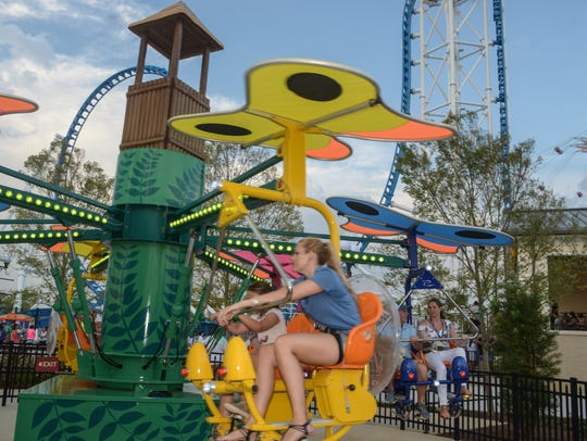 Riders fly by on the Flutter By at The Park at OWA in Foley, Alabama. Downtown OWA will hold a Community Safety Day on Saturday with free and interactive live demonstrations.
