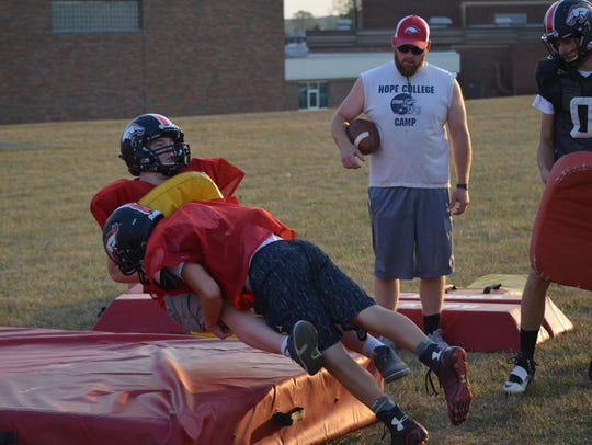 Bellevue players go through a tackling drill. The Broncos