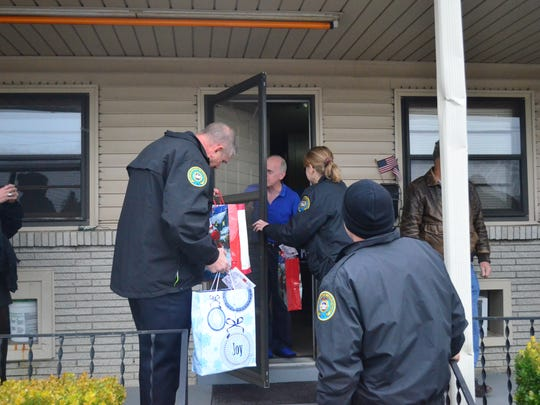 Members of the Gallatin Police Department hand out