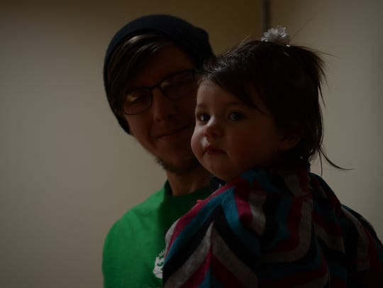 Brian Borello, 25, holds his 1-year-old daughter Freya