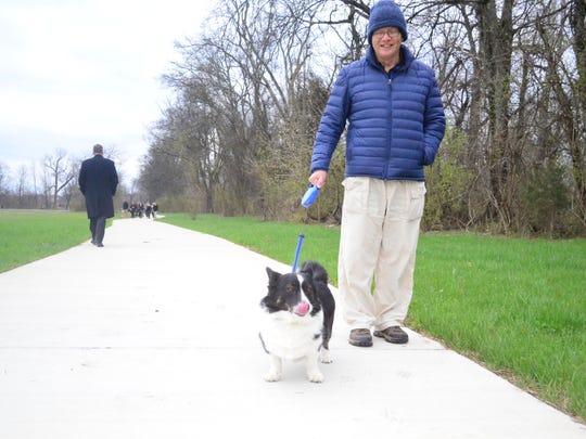 Cardigan corgi Rex and his owner Steve Ticaric walk