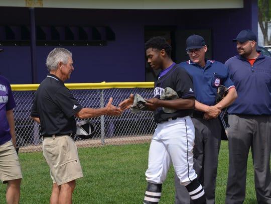 Lakeview's  Jalen Watkins presents former Spartan coach