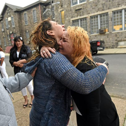 Outside May Funeral Home, family members grieve the